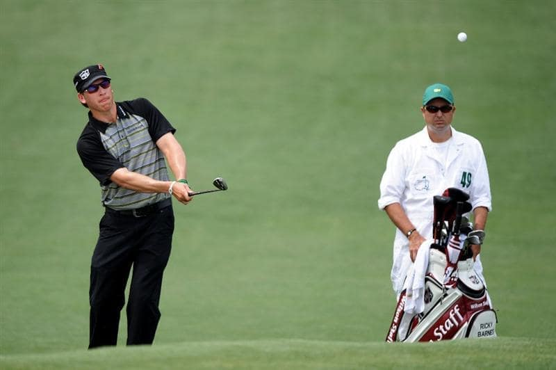 AUGUSTA, GA - APRIL 09:  Ricky Barnes chips on the second hole as his caddie Ray Farnell looks on during the third round of the 2011 Masters Tournament at Augusta National Golf Club on April 9, 2011 in Augusta, Georgia.  (Photo by Harry How/Getty Images)
