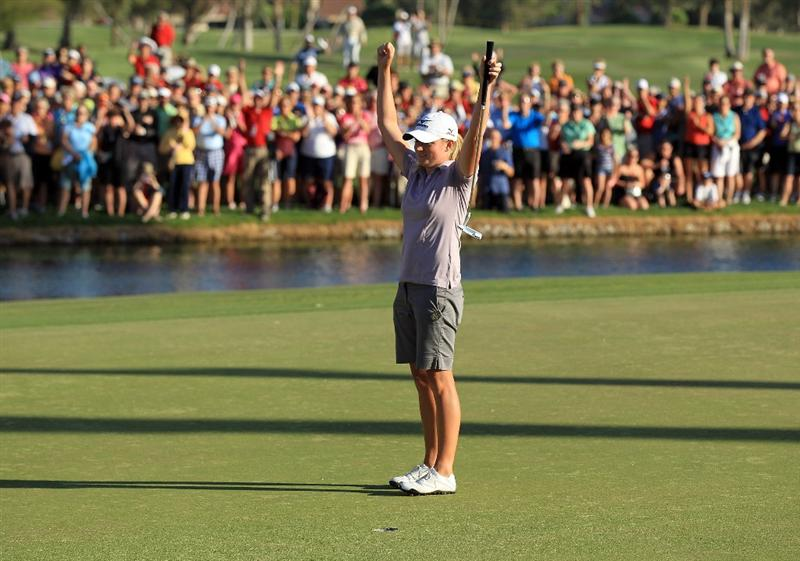RANCHO MIRAGE, CA - APRIL 03:  Stacy Lewis of the USA raises her arms after securing victory on the 18th green during the final round of the 2011 Kraft Nabisco Championship on the Dinah Shore Championship Course at the Mission Hills Country Club on April 3, 2011 in Rancho Mirage, California.  (Photo by David Cannon/Getty Images)