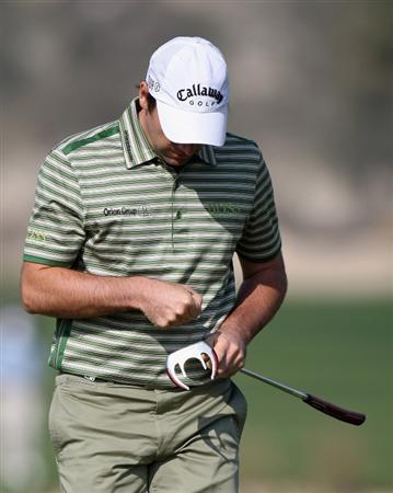 DOHA, QATAR - JANUARY 22:  Oliver Wilson of England looks dejected after a missed putt on the 15th green during the first round of the Commercialbank Qatar Masters at the Doha Golf Club on January 22,2009 in Doha, Qatar.  (Photo by Ross Kinnaird/Getty Images)