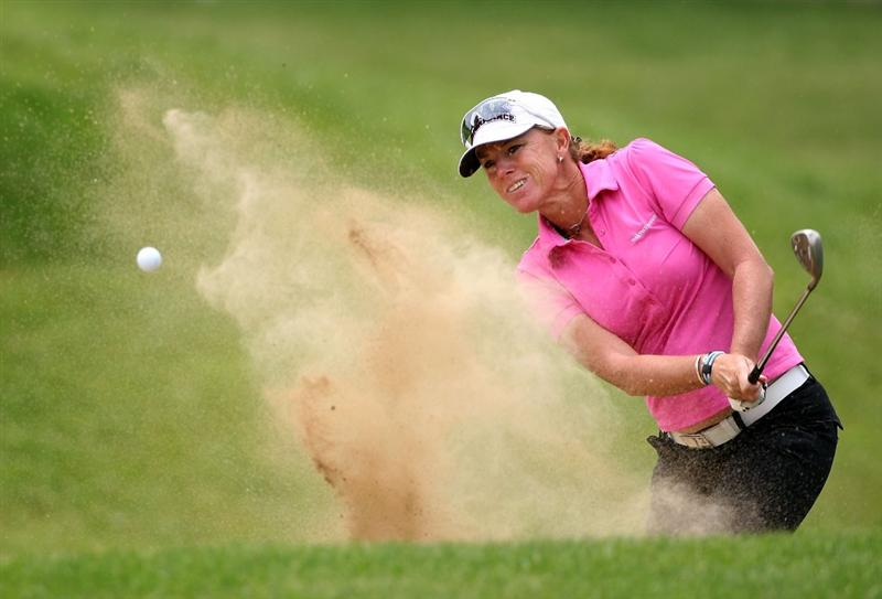 SPRINGFIELD, IL - JUNE 06:  Helen Alfredsson of Sweden chips out of the bunker onto the first hole green during the third round of the LPGA State Farm Classic golf tournament at Panther Creek Country Club on June 6, 2009 in Springfield, Illinois.  (Photo by Christian Petersen/Getty Images)