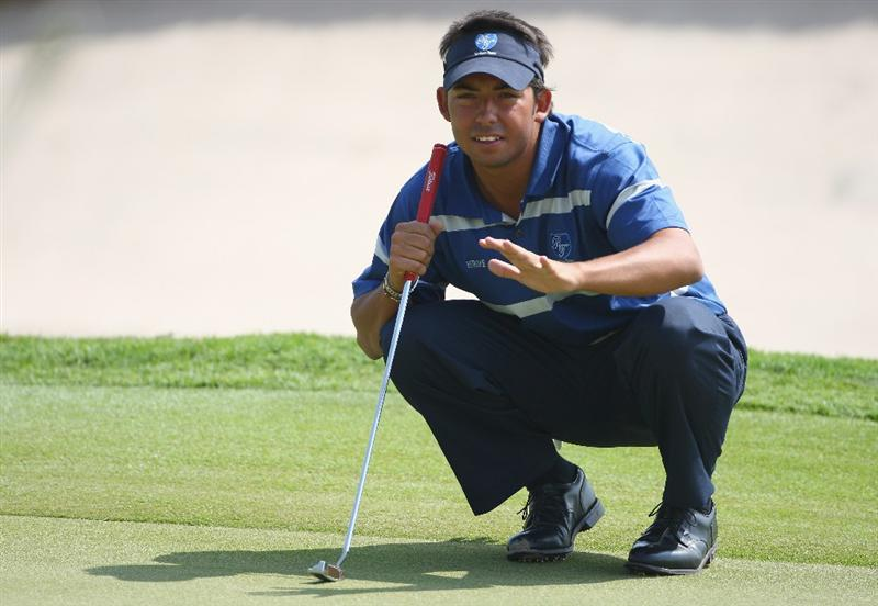 BANGKOK, THAILAND - JANUARY 09:  Pablo Larrazabal of Spain lines up a put during the foursomes on Day one of The Royal Trophy at the Amata Spring Country Club on January 9, 2009 in Bangkok, Thailand.  (Photo by Ian Walton/Getty Images)