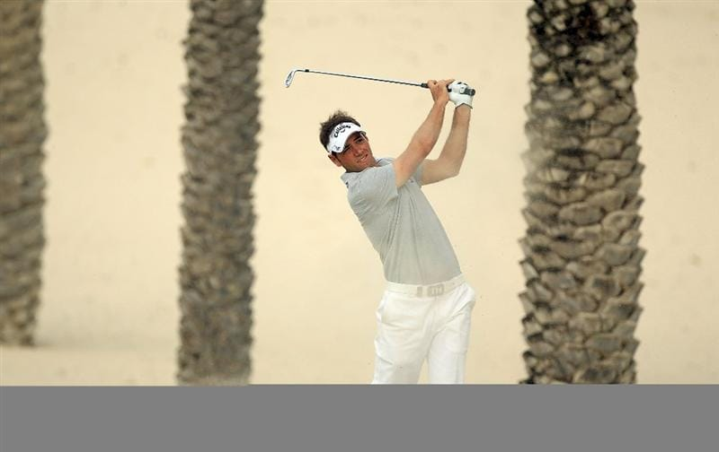 DUBAI, UNITED ARAB EMIRATES - FEBRUARY 04:  Nick Dougherty of  plays his second shot to the par 4, 14th hole during the first round of the 2010 Omega Dubai Desert Classic on the Majilis Course at the Emirates Golf Club on February 4, 2010 in Dubai, United Arab Emirates.  (Photo by David Cannon/Getty Images)