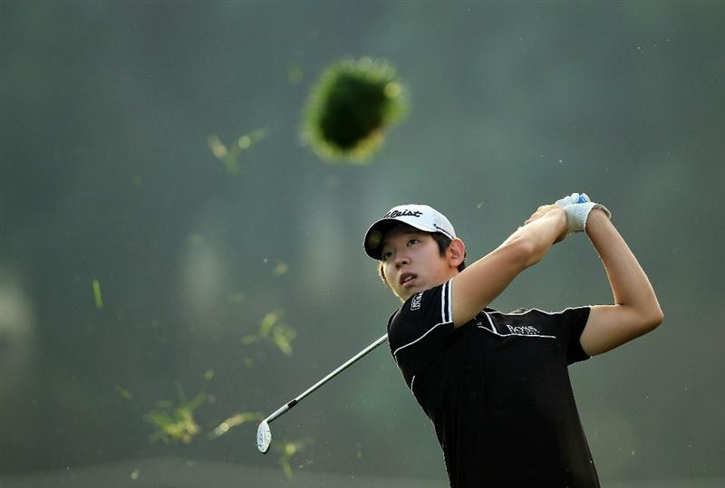DUBAI, UNITED ARAB EMIRATES - FEBRUARY 11:  Seung-yul Noh of South Korea plays his second shot at the 12th hole during the second round of the 2011 Omega Dubai Desert Classic on the Majilis Course at the Emirates Golf Club on February 11, 2011 in Dubai, United Arab Emirates.  (Photo by David Cannon/Getty Images)