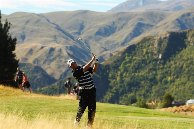 QUEENSTOWN, NEW ZEALAND - MARCH 15:  Alex Prugh of the USA plays an approach shot on the 14th hole during day four of the New Zealand Men's Open Championship at The Hills Golf Club on March 15, 2009 in Queenstown, New Zealand.  (Photo by Phil Walter/Getty Images)
