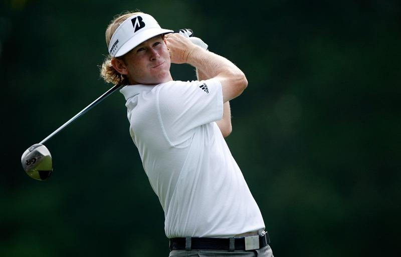 GREENSBORO, NC - AUGUST 20:  Brandt Snedeker watches his tee shot on the 18th hole during the first round of the Wyndham Championship at Sedgefield Country Club on August 20, 2009 in Greensboro, North Carolina.  (Photo by Streeter Lecka/Getty Images)
