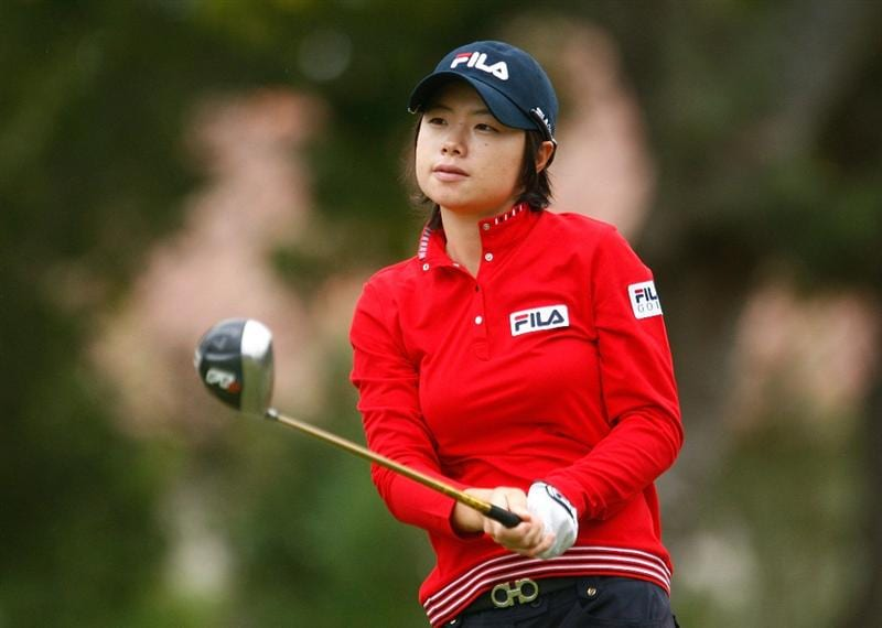 RICHMOND, TX - NOVEMBER 20:  Eun-Hee Ji of South Korea watches her tee shot on the first hole during the second round of the LPGA Tour Championship presented by Rolex at the Houstonian Golf and Country Club on November 20, 2009 in Richmond, Texas.  (Photo by Scott Halleran/Getty Images)