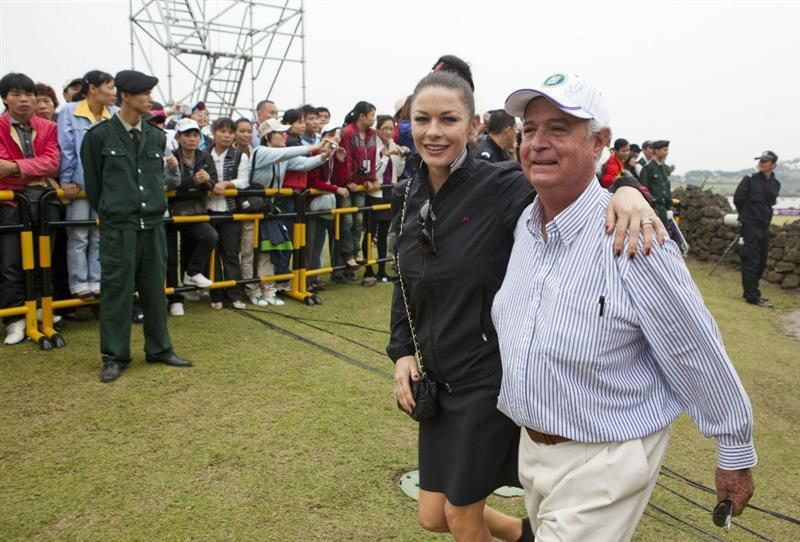 HAIKOU, CHINA - OCTOBER 31:  Actress Catherine Zeta-Jones walks with Father of Lorena Ochoa of Maxico after Lorena Ochoa winning the Mission Hills Start Trophy tournament at Mission Hills Resort on October 31, 2010 in Haikou, China. The Mission Hills Star Trophy is Asia's leading leisure liflestyle event which features Hollywood celebrities and international golf stars.  (Photo by Athit Perawongmetha/Getty Images for Mission Hills)