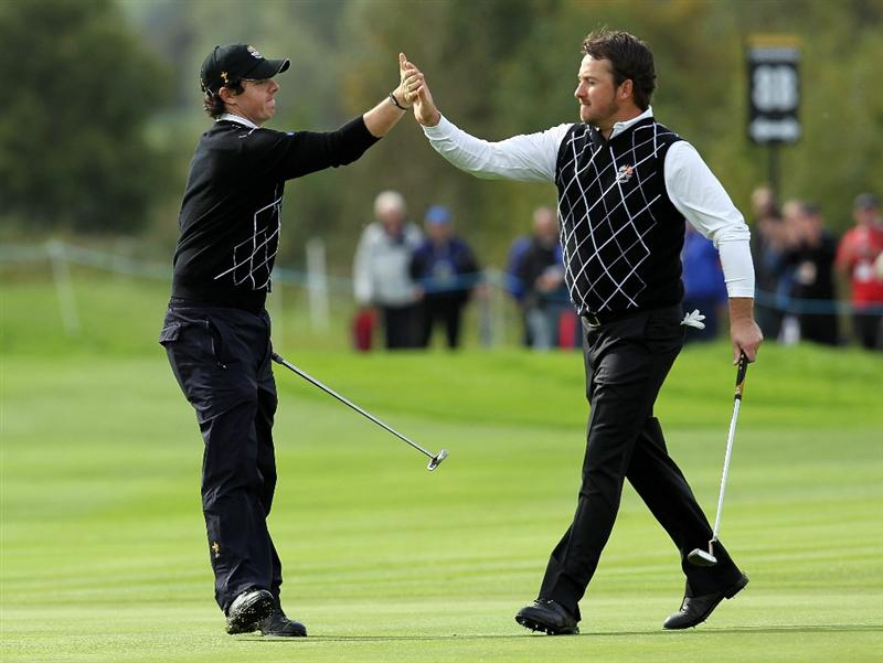 NEWPORT, WALES - OCTOBER 02:  Rory McIlroy of Europe celebrates holing a putt on the 8th green with team mate Graeme McDowell (R) during the rescheduled Afternoon Foursome Matches during the 2010 Ryder Cup at the Celtic Manor Resort on October 2, 2010 in Newport, Wales.  (Photo by Andy Lyons/Getty Images)