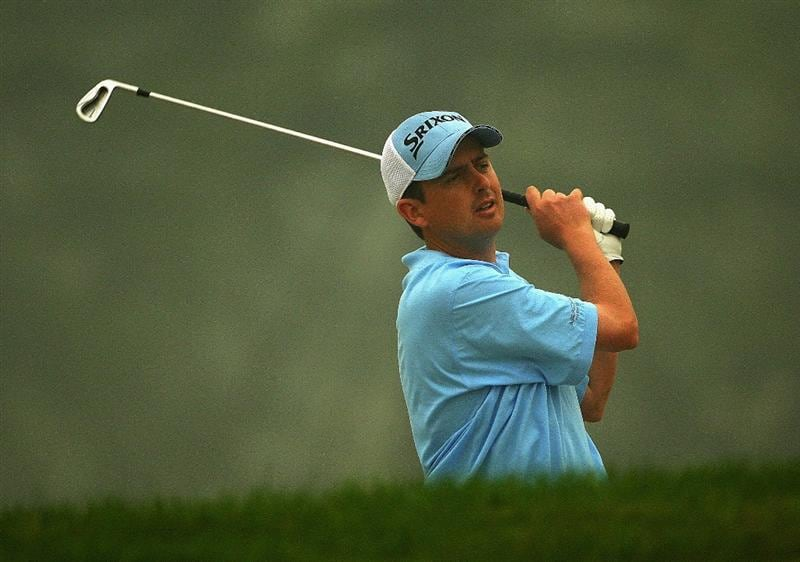 SHANGHAI, CHINA - NOVEMBER 06:  Peter Lawrie of Ireland hits his approach shot on the ninth hole during the first round of the HSBC Champions at Sheshan International Golf Club on November 6, 2008 in Shanghai, China.  (Photo by Andrew Redington/Getty Images)
