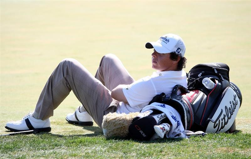 VILAMOURA, PORTUGAL - OCTOBER 17:  Rory McIlroy of Northern Ireland lies against his golf bag on the 17th hole during the third round of the Portugal Masters at the Oceanico Victoria Golf Course on October 17, 2009 in Vilamoura, Portugal.  (Photo by Andrew Redington/Getty Images)