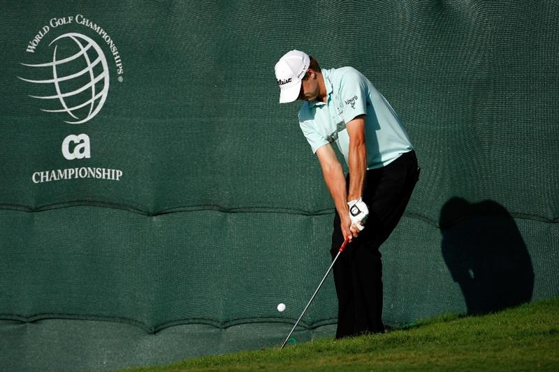 DORAL, FL - MARCH 14:  Nick Watney hits his third shot on the 18th hole during round three of the World Golf Championships-CA Championship on March 14, 2009 at the Doral Golf Resort and Spa in Miami, Florida.  (Photo by Jamie Squire/Getty Images)