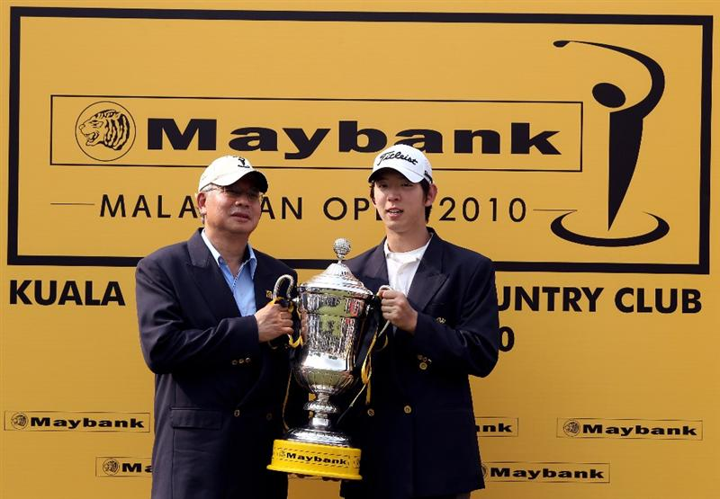 KUALA LUMPUR, MALAYSIA - MARCH 07:  Mohd Najib Tun Razak, The Prime Minister of Malasia presents Noh Seung-Yul of Korea with the winners trophy after the final round of the Maybank Malaysia Open at the Kuala Lumpur Golf & Country on March 7, 2010 in Kuala Lumpur, Malaysia.  (Photo by Ross Kinnaird/Getty Images)