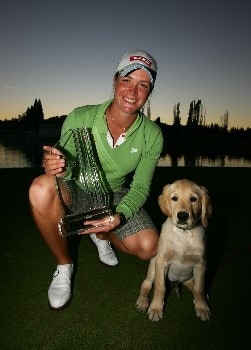 DANVILLE, CA - OCTOBER 7:  Suzann Pettersen of Norway poses with the winner's trophy and the golf club dog Bogey after winning the tournament by making a birdie putt on the second sudden death playoff hole on the 18th green during the final round of the LPGA Longs Drugs Challenge at the Blackhawk Country Club October 7, 2007 in Danville, California.  (Photo by Robert Laberge/Getty Images)