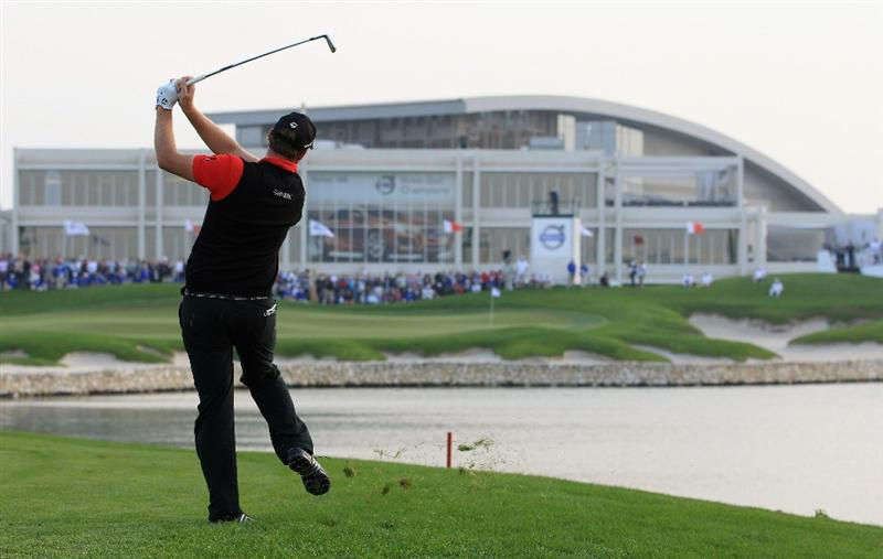BAHRAIN, BAHRAIN - JANUARY 30:  Peter Hanson of Sweden hits his second shot on the 18th hole during the final round of the Volvo Golf Champions at The Royal Golf Club on January 30, 2011 in Bahrain, Bahrain.  (Photo by Andrew Redington/Getty Images)
