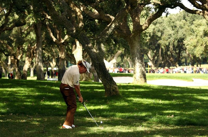 SOTOGRANDE, SPAIN - OCTOBER 31:  Miguel Angel Jimenez of Spain plays from the trees on the 8th during the final round of the Andalucia Valderrama Masters at Club de Golf Valderrama on October 31, 2010 in Sotogrande, Spain.  (Photo by Richard Heathcote/Getty Images)