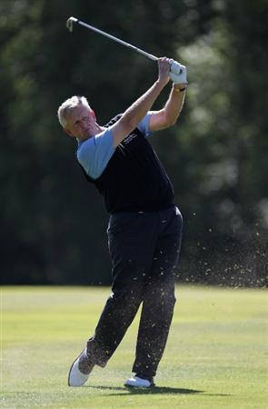 VIRGINIA WATER, ENGLAND - MAY 25:  Colin Montgomerie of Scotland plays an approach shot during the Pro-Am round prior to the BMW PGA Championship at Wentworth Club on May 25, 2011 in Virginia Water, England.  (Photo by Ross Kinnaird/Getty Images)