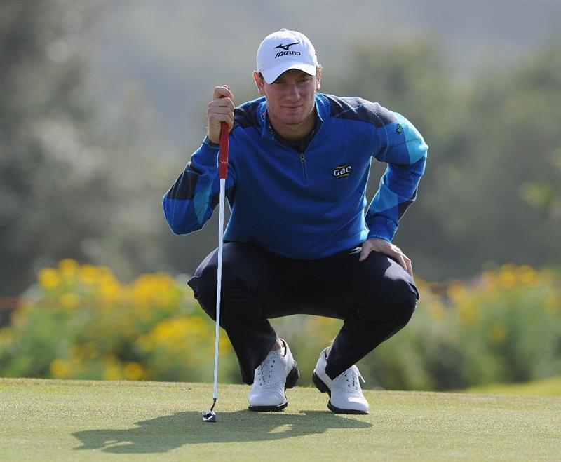 RAGUSA, ITALY - MARCH 18:  Chris Wood of England lines up his putt on the 11th hole during the second round of the Sicilian Open at the Donnafugata golf resort and spa on March 18, 2011 in Ragusa, Italy.  (Photo by Stuart Franklin/Getty Images)