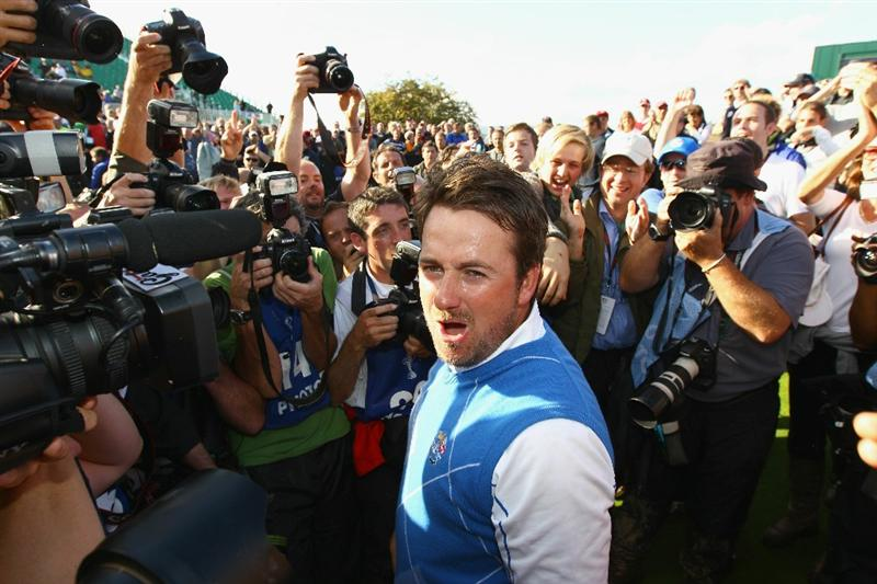 NEWPORT, WALES - OCTOBER 04:  Graeme McDowell of Europe celebrates his 3&1 win to secure victory for  the European team on the 17th green in the singles matches during the 2010 Ryder Cup at the Celtic Manor Resort on October 4, 2010 in Newport, Wales.  (Photo by Richard Heathcote/Getty Images)