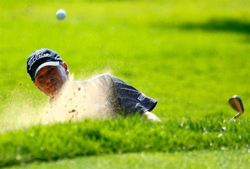 LEMONT, IL - SEPTEMBER 10:  Steve Stricker plays a bunker shot on the fifth hole during the first round of the BMW Championship held at Cog Hill Golf & CC on September 10, 2009 in Lemont, Illinois.  (Photo by Scott Halleran/Getty Images)