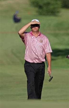 MILWAUKEE - JULY 19: Bo Van Pelt looks for the location of his ball on the 18th green as he walks up the fairway during the final round of the U.S. Bank Championship on July 19, 2009 at the Brown Deer Park golf course in Milwaukee, Wisconsin. (Photo by Jonathan Daniel/Getty Images)