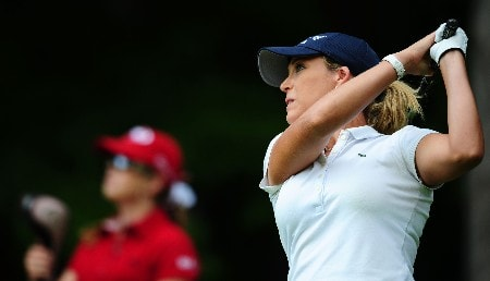 OTTAWA - AUGUST 15:  Cristie Kerr makes a tee shot on the 13th hole as Paula Creamer looks on during the second round of the CN Canadian Women's Open at the Ottawa Hunt and Golf Club on August 15, 2008 in Ottawa, Ontario, Canada.  (Photo by Robert Laberge/Getty Images)