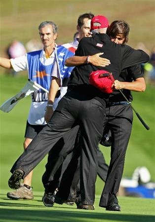 NEWPORT, WALES - OCTOBER 04: Rickie Fowler of the USA hugs Corey Pavin USA Team captain on the 18th green in the singles matches during the 2010 Ryder Cup at the Celtic Manor Resort on October 4, 2010 in Newport, Wales. (Photo by Andy Lyons/Getty Images)