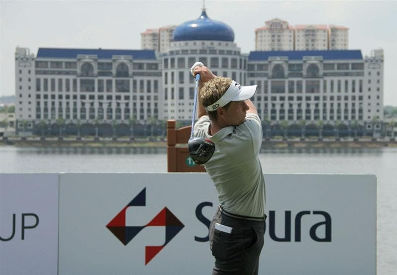 KUALA LUMPUR, MALAYSIA - OCTOBER 28: Luke Donald of England tees off on the 11th hole during day one of the CIMB Asia Pacific Classic at The MINES Resort & Golf Club on October 28, 2010 in Kuala Lumpur, Malaysia. (Photo by Stanley Chou/Getty Images)