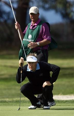 LA JOLLA, CA - FEBRUARY 05:  Stuart Appleby of Australia lines up a putt with caddie during the 1st Round of the Buick Invitational at the Torrey Pines North Course on February 5, 2009 in La Jolla, California. (Photo by Donald Miralle/Getty Images)