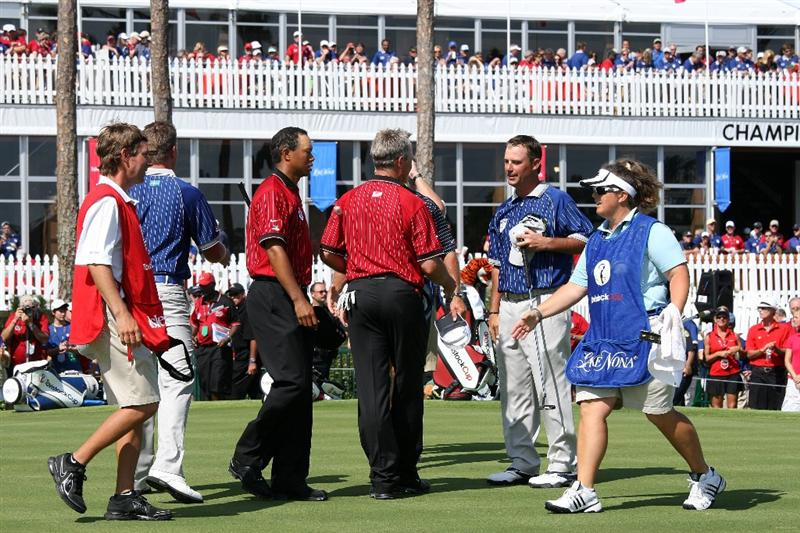ORLANDO, FL - MARCH 16:  Tiger Woods and John Cook of the USA and the Isleworth team shake hands with Henrik Stenson of Sweden and Chris DiMarco of the USA and the Lake Nona Team shake hands at the 18th hole during the first day of the 2009 Tavistock Cup at the Lake Nona Golf and Country Club, on March 16, 2009 in Orlando, Florida  (Photo by David Cannon/Getty Images)