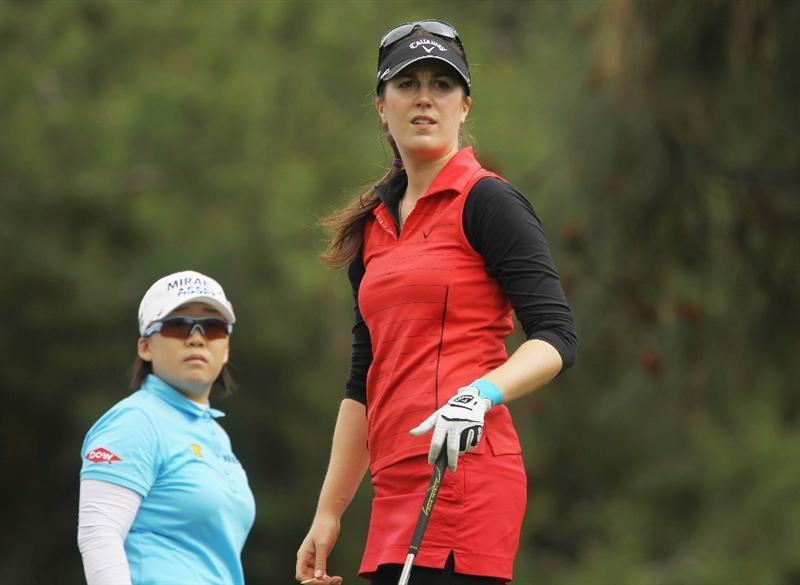 CITY OF INDUSTRY, CA - MARCH 27:  Sandra Gal of Germany (R) watches her tee shot on the ninth hole as Jiyai Shin of South Korea looks on during the final round of the Kia Classic on March 27, 2011 at the Industry Hills Golf Club in the City of Industry, California.  (Photo by Scott Halleran/Getty Images)