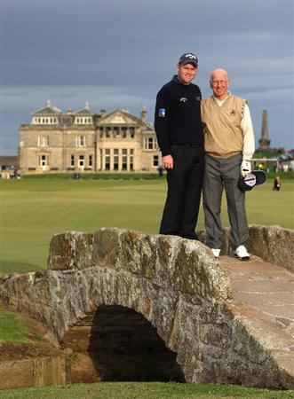 ST. ANDREWS, SCOTLAND - OCTOBER 01:  Alastair Forsyth of Scotland (left) stands with Sir Bobby Charlton, England football legend, on the Swilken Bridge on the 18th hole during the first round of The Alfred Dunhill Links Championship at The Old Course on October 1, 2009 in St. Andrews, Scotland. (Photo by Andrew Redington/Getty Images)