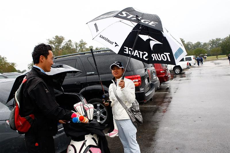 RICHMOND, TX - NOVEMBER 21:  Ai Miyazato of Japan loads her golf clubs into her car after play was delayed at the start of the continuation of the second round of the LPGA Tour Championship presented by Rolex at the Houstonian Golf and Country Club on November 21, 2009 in Richmond, Texas.  (Photo by Scott Halleran/Getty Images)