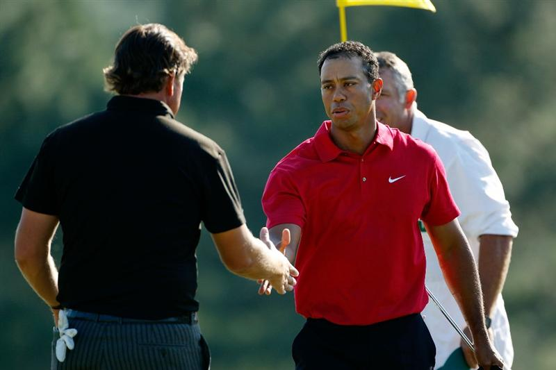 AUGUSTA, GA - APRIL 12:  Tiger Woods shakes hands with Phil Mickelson during the final round of the 2009 Masters Tournament at Augusta National Golf Club on April 12, 2009 in Augusta, Georgia.  (Photo by Jamie Squire/Getty Images)