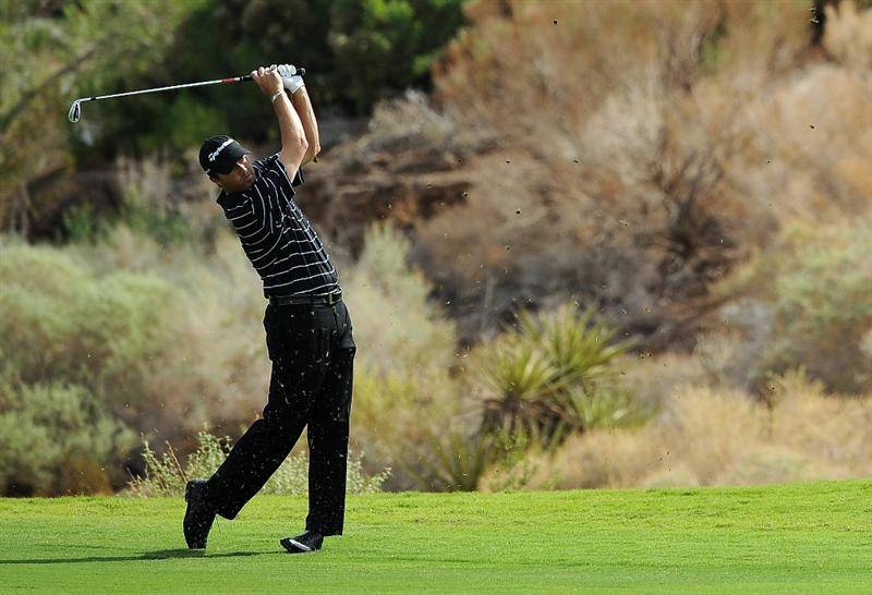 LAS VEGAS, NV - OCTOBER 21: Ryan Palmer hits his approach shot on the 18th hole during the first round of the Justin Timberlake Shriners Hospitals for Children Openon October 21, 2010 in Las Vegas, Nevada. (Photo by Steve Dykes/Getty Images)