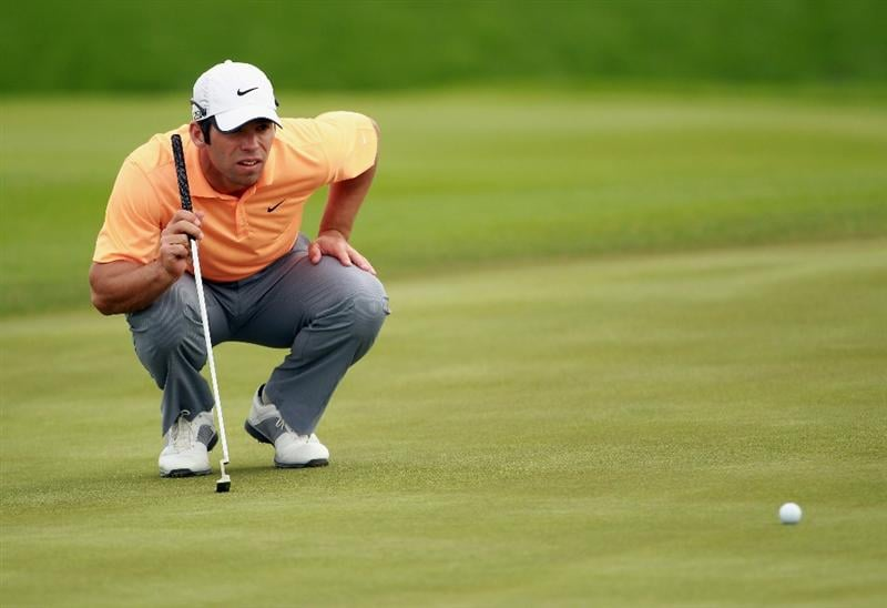 BAHRAIN, BAHRAIN - JANUARY 29:  Paul Casey of England lines up a putt on the 13th hole during the third round of the Volvo Golf Champions at The Royal Golf Club on January 29, 2011 in Bahrain, Bahrain.  (Photo by Andrew Redington/Getty Images)