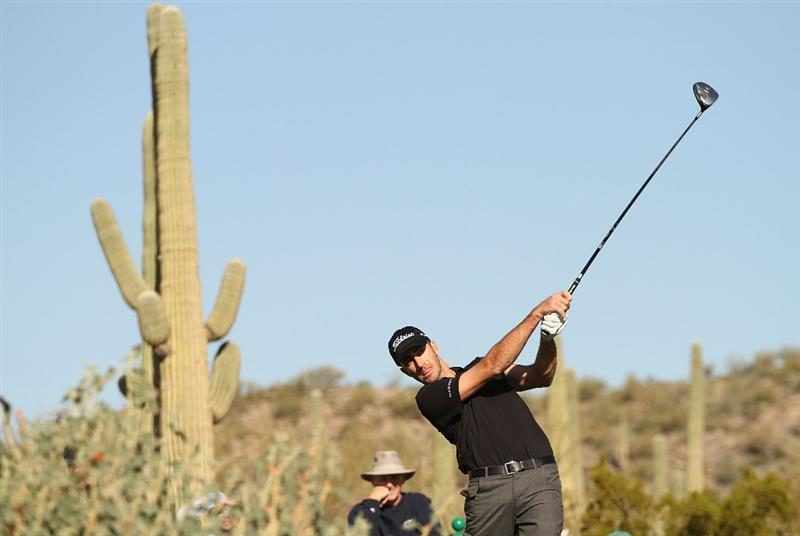 MARANA, AZ - FEBRUARY 17:  Geoff Ogilvy of Australia tees off on the seventh hole during round one of the Accenture Match Play Championship at the Ritz-Carlton Golf Club on February 17, 2010 in Marana, Arizona.  (Photo by Darren Carroll/Getty Images)
