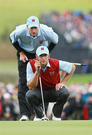NEWPORT, WALES - OCTOBER 03:  Dustin Johnson of the USA lines up a putt with Jim Furyk (L) during the  Fourball & Foursome Matches during the 2010 Ryder Cup at the Celtic Manor Resort on October 3, 2010 in Newport, Wales.  (Photo by Andrew Redington/Getty Images)