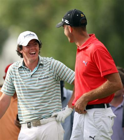 DUBAI, UNITED ARAB EMIRATES - NOVEMBER 22:  Rory McIlroy of Northern Ireland and Geoff Ogilvy of Australia share a laugh during the final round of the Dubai World Championship on the Earth Course, Jumeriah Golf Estates on November 22, 2009 in Dubai, United Arab Emirates.  (Photo by Ross Kinnaird/Getty Images)