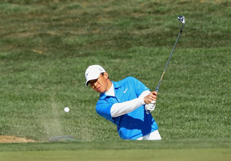 SCOTTSDALE, AZ - FEBRUARY 04:  Anthony Kim hits out of the bunker onto the 14th hole green during the first round of the Waste Management Phoenix Open at TPC Scottsdale on February 4, 2011 in Scottsdale, Arizona.  (Photo by Christian Petersen/Getty Images)