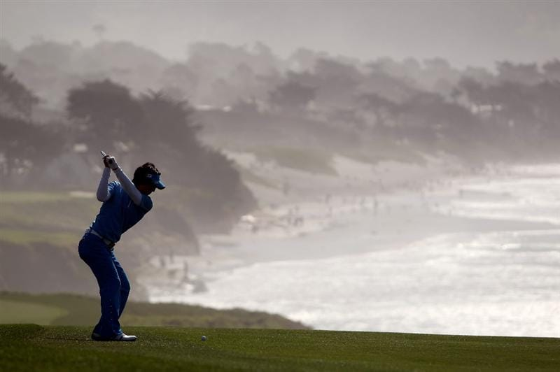 PEBBLE BEACH, CA - FEBRUARY 13:  Ryo Ishikawa of Japan hits his second shot on the ninth hole during round three of the AT&T Pebble Beach National Pro-Am at Pebble Beach Golf Links on February 13, 2010 in Pebble Beach, California.  (Photo by Ezra Shaw/Getty Images)