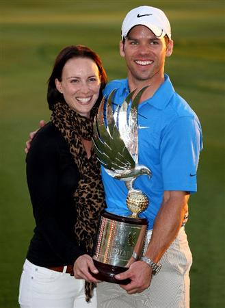 ABU DHABI, UNITED ARAB EMIRATES - JANUARY 18:  Recently-married Paul Casey of England and his wife Jocelyn pose with the trophy after winning The Abu Dhabi Golf Championship at Abu Dhabi Golf Club on January 18, 2009 in Abu Dhabi, United Arab Emirates.  (Photo by Andrew Redington/Getty Images)