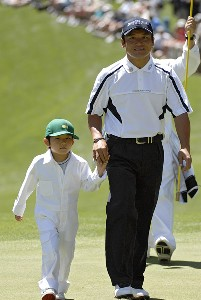 Shigeki Maruyama and his son Sean during the par 3 contest prior to the 2006 Masters at the Augusta National Golf Club in Augusta, Georgia on April 5, 2006.Photo by Hunter Martin/WireImage.com