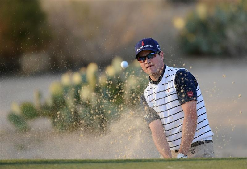 MARANA, AZ - FEBRUARY 23:  Zach Johnson plays his bunker shot on the 117th hole during the first round of the World Golf Championships-Accenture Match Play Championship held at The Ritz-Carlton Golf Club, Dove Mountain on February 23, 2011 in Marana, Arizona.  (Photo by Stuart Franklin/Getty Images)