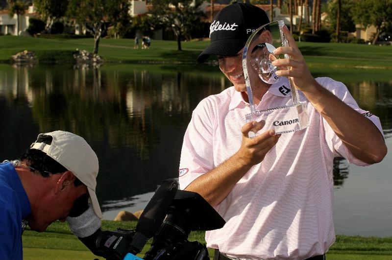 LA QUINTA, CA - JANUARY 25:  Bill Haas holds the trophy for a video camera at the Palmer Private course at PGA West after winning the Bob Hope Classic on January 25, 2010 in La Quinta, California.  (Photo by Stephen Dunn/Getty Images)