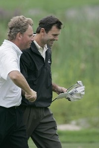 Len Mattiace (R) is congratulated by Mathias Gronberg after shooting a 69 during the second round of the 2006 Deutsche Bank Championship held at TPC Boston in Norton, Massachusetts on September 2, 2006.Photo by Michael Cohen/WireImage.com