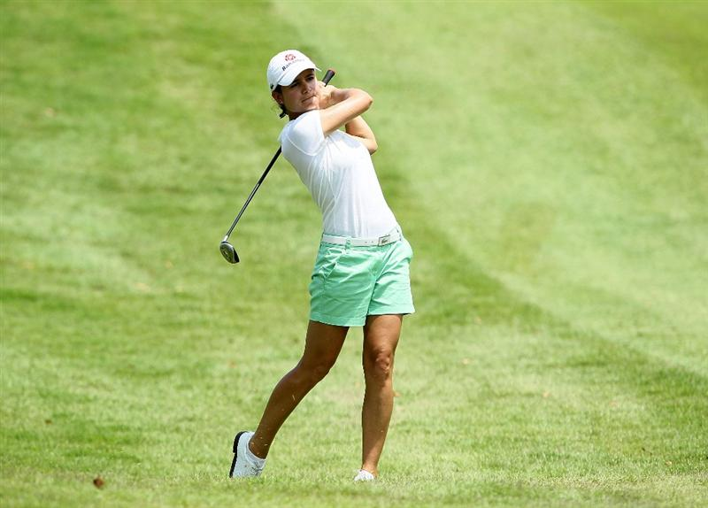SINGAPORE - FEBRUARY 26:  Lorena Ochoa of Mexico  hits her second shot on the 9th hole during the second round of the HSBC Women's Champions at Tanah Merah Country Club on February 26, 2010 in Singapore, Singapore.  (Photo by Andy Lyons/Getty Images)