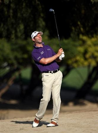 DUBAI, UNITED ARAB EMIRATES - JANUARY 30:  Bradley Dredge of Wales watches his second shot on the 14th hole during the second round of the Dubai Desert Classic on the Majilis course at Emirates Golf Club on January 30, 2009 in Dubai, United Arab Emirates.  (Photo by Andrew Redington/Getty Images)