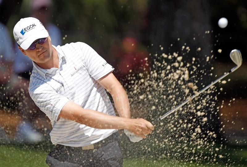 HILTON HEAD ISLAND, SC - APRIL 15:  Zach Johnson hits a bunker shot on the seventh hole during the first round of the Verizon Heritage at the Harbour Town Golf Links on April 15, 2010 in Hilton Head lsland, South Carolina.  (Photo by Scott Halleran/Getty Images)