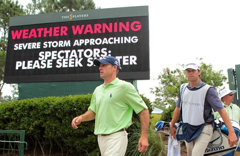 PONTE VEDRA BEACH, FL - MAY 14:   Jonathan Byrd and his caddie Adam Hayes walk past a warning sign after play was suspended due to severe storms during the third round of THE PLAYERS Championship held at THE PLAYERS Stadium course at TPC Sawgrass on May 14, 2011 in Ponte Vedra Beach, Florida.  (Photo by Scott Halleran/Getty Images)