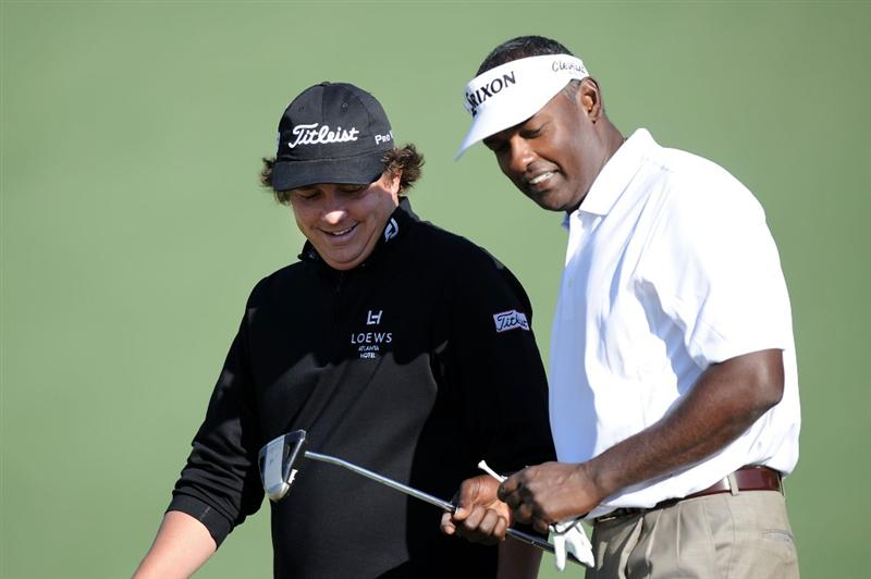 AUGUSTA, GA - APRIL 09:  Vijay Singh of Fiji (R) talks with Jason Dufner on the second fairway during the second round of the 2010 Masters Tournament at Augusta National Golf Club on April 9, 2010 in Augusta, Georgia.  (Photo by Harry How/Getty Images)
